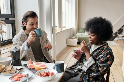 a couple starting a healthy habit of eating fruit at breakfast