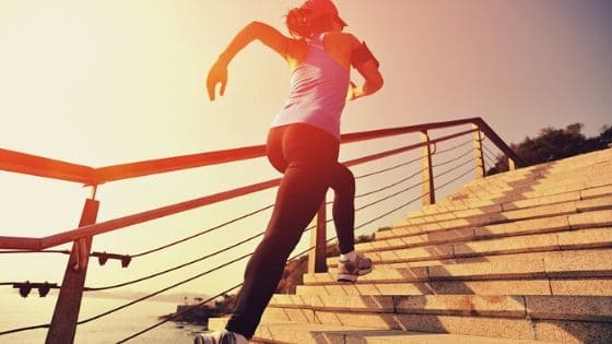 motivated woman running up stairs