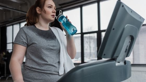 woman working out on treadmill and starting a healthy habit