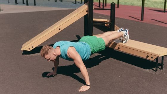 man working out on playground