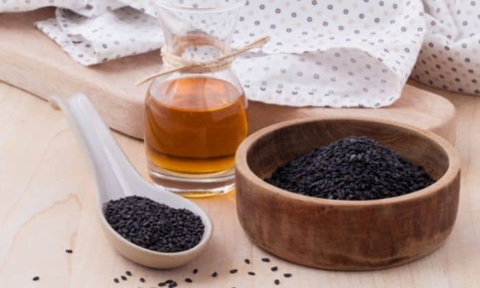 picture of best black seed oil and seeds on table